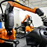 ABB robots boost car painting line