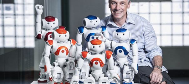 Peter-Corke-with-a-collection-of-Aldebaran-s-NAO-robots_1.jpg