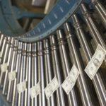 Dollar bills on conveyor belt