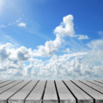 Cloudy blue sky with wooden platform