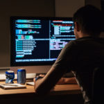 man-and-a-computer_istock_by_deandrobot