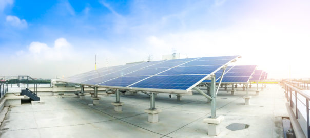 Soft Focus Of Solar Panels Or Solar Cells On Factory Rooftop Or