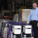 Redflow CEO Richard Aird with ZBM2 batteries. picture courtesy of Redflow
