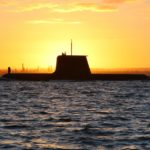 HMAS Collins sails out through the channel in Cockburn Sound at sunrise. Source: navy