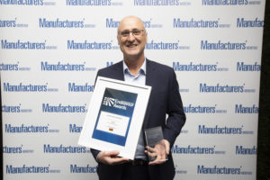 Paul Markwick, General Manager - Victoria / Tasmania at SAGE Automation receiving the award