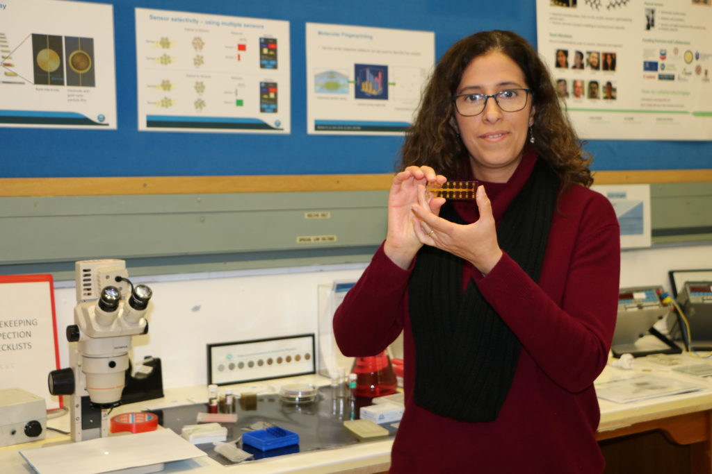 Andrea Sosa Pintos, Team Leader – Nanosensors and Systems shows the chemiresistor sensor array she and her team have developed.