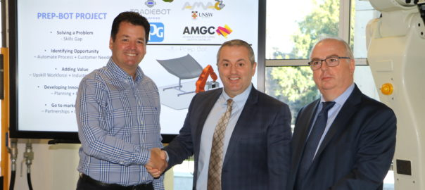 AMGC state director Michael Sharpe, Tradiebot chief creator Mario Dimovski and PPG Industries Australia marketing director Kevin Woolerton at the signing ceremony in UNSW.