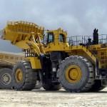 Komatsu cuts profit target as mining demand drops