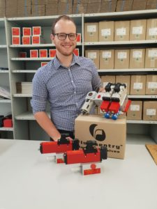 """Fluidsentry operations manager Jason Hodges displays the new PX2M ½"""" pneumatic safety valve system, which the company will launch in June 2018."""